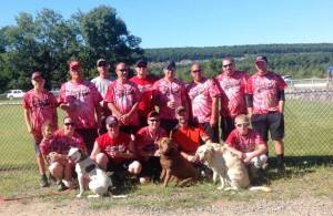 "Pictured are members of the Lansford Fire Company Softball Team in no particular order. In photo are Nicki Diehl - holding Matt's niece Julliana Aungst; Nathan Krajcirik and his dog ""Rocko""; Alex Matika; David Aungst with dogs ""Bindi"" and ""Koa""; Kelly Mcklveen; Zack Kindt; Scott Reynolds; Lou Jimenez; Bryn Zellner; Danny Pucksar; Chris Aungst; Frank Marek; Mike Doerr; and Sebastian Reynolds."