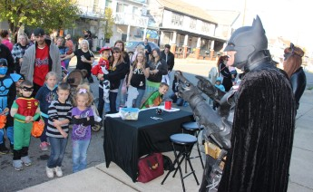 Kids listen to anti-bullying presentation by Batman during the event.
