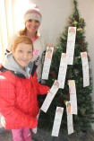 Lisa Christman and AnnMarie Skasko pick a tag off the Angel Tree at the Tamaqua Salvation Army. Both are with REDCO.
