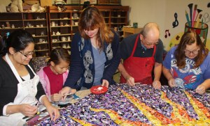Working together on the time-consuming project are, from left, Marcia Shellhammer, Izabella Shellhammer, creator Kim East, clay instructor Craig Bulger, and Irene Miller. Numerous others helped, but aren't pictured.