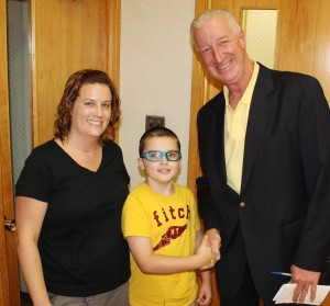 Pictured are Keenan, 8, his mother Shanna Cook, and Tamaqua Borough Councilman Dan Evans.
