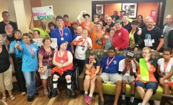 Athletes with Special Olympics of Schuylkill County and riders with the Dream Ride come together for a group photo.