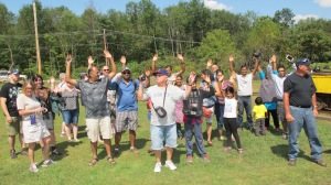 Mine tours guest hold their hands up while being questioned by Civil War reenactors during the event.