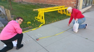 Tamaqua Historical Society members Linda Yulanavage and Gary Price chalk the sidewalk for vendors.