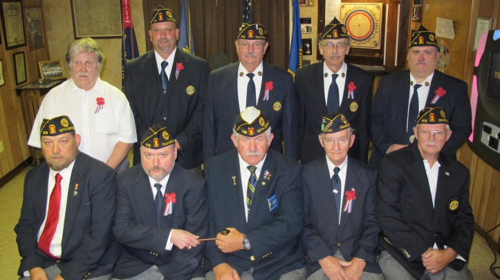 Pictured from front left are Scott Quin, District 13 officer; Chris Behler, post Commander; Marc Burlile, District 13 Commander; Charlie Hollenbach, historian/chaplain; and John Flynn, District 13 officer. From back left are Ed Murphy, First Vice Commander; Tom Isleib, Third Vice Commander; Dave Meredith, adjutant; Jack Kulp, Second Vice Commander; and Mike Morgans, financial secretary.