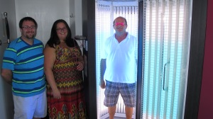 Pictured are managers Stephen Kantor, Courtney Bruno and John Bruno (inside upright tanning bed).