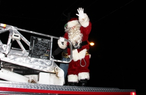 Santa arrived by Lansford Fire Company fire truck.