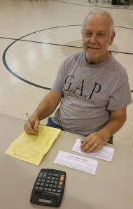 Pictured is volunteer John Leibenguth of Tamaqua helping to register individuals and families for assistance.