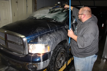 Todd Harper of The Washery Carwash washes a veteran's truck free of charge.