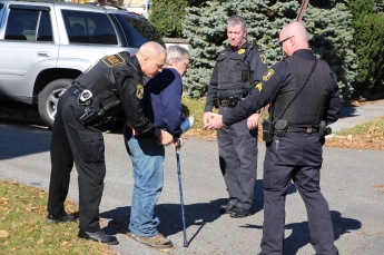Tamaqua patrolman Rick Bekesy searches Steven Marsicano, 48, of Tamaqua, Monday morning. Also pictured are officer Cpl Henry Woods, and Police Chief Rick Weaver.