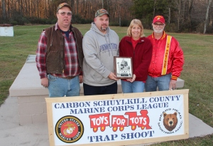 Pictured from left are event co-chairs Mike Ward and Jim Shaup; and Schuylkill Carbon Marine Corps League members Cheryl Laub, Toys For Tots coordinator, and James Laub.