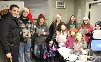 The festive group found time to sing a quick carol at the Coaldale Police Department.