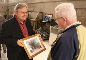 """Dale Freudenberger, President, Tamaqua Historical Society, shows a """"before"""" photo of the museum to Representative Jerry Knowles."""