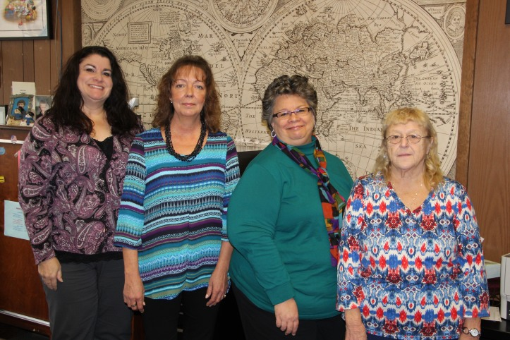 From left are staff Ann Marie Calabrese of 3 years, Wanda Kropp of 2 years, Susan Anderson of 1 year, and Ann Kline of 16 years.