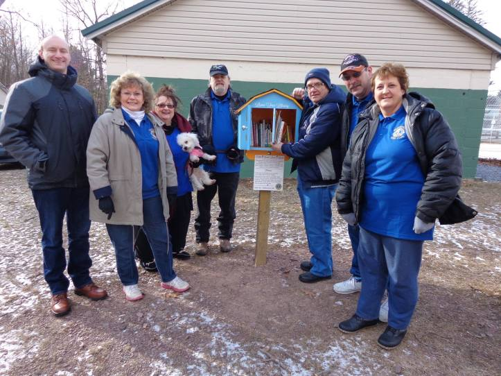 Credit District 14-U Lions / Pictured here are Dennis Schock, Tweedle Park Pres., Lion members Christine Embick, Bonnie Urban holding 'Angel', Nick Urban, Charlie Hettler, Del Embick and Teresa Kairewich.