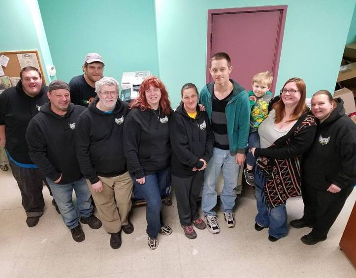 From left are volunteers Frankie Latham, John Sienkiewicz, Matt Moyer, Jesse Durning, Tammy Sienkiewicz, Michele Mehallic, Andrew Leibenguth, Melissa Latham with Abraham, and Lorraine Durning.