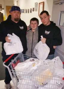 Pictured helping are, from left, Justin E. Hill; Jaiden Hill, 13; and Justin C. Hill.