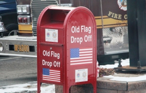 old-worn-ripped-flag-drop-off-in-front-of-mcadoo-fire-company-mcadoo-2-5-2017